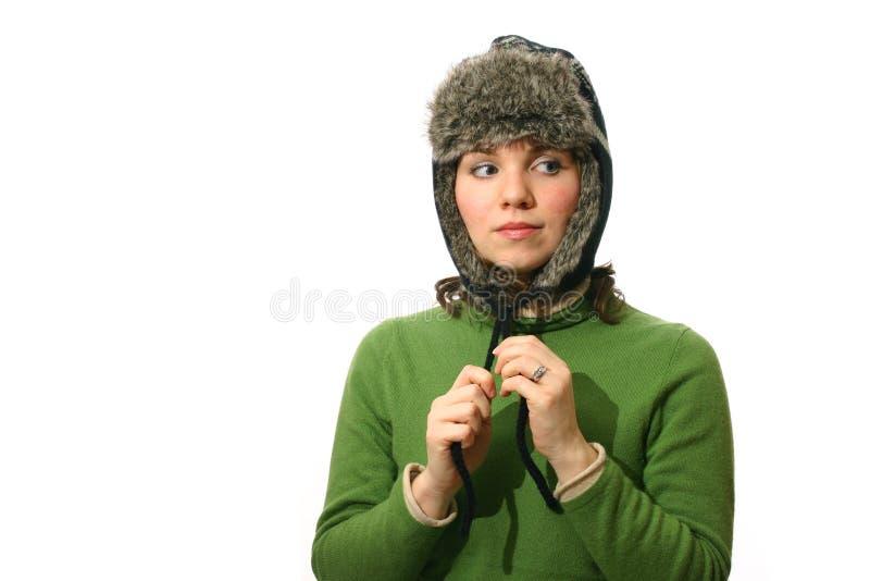Woman wearing fur lined hat