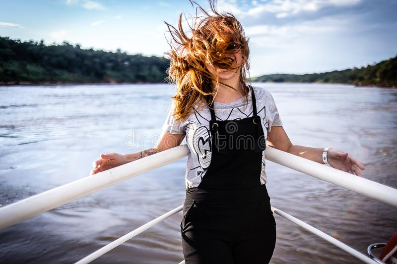Woman Wearing Gray Shirt and Black Overalls on Boat stock images