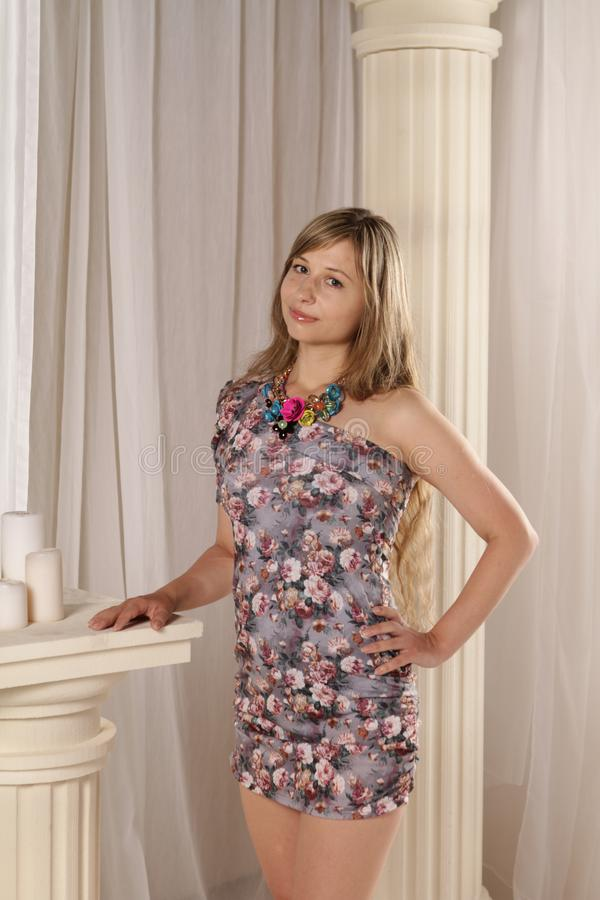 Woman Wearing Gray, White, and Red Floral One-shoulder Dress royalty free stock image