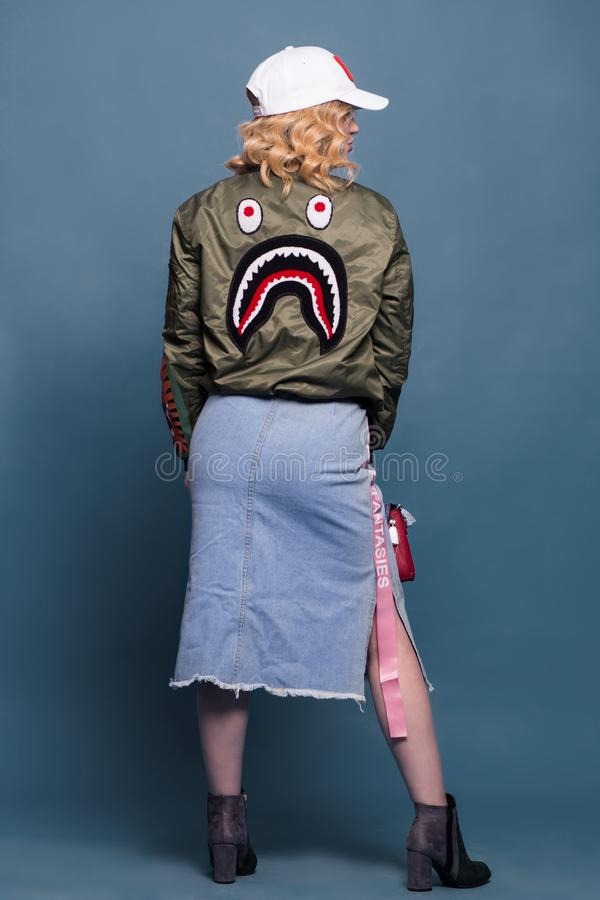 Woman Wearing Green Bathing Ape Jacket and Bottom Skirt royalty free stock images