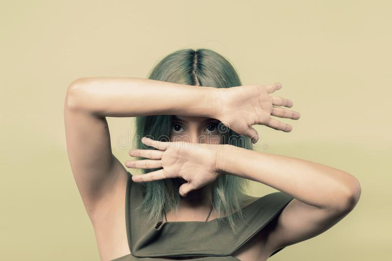 Woman Wearing Green Sleeveless Top Covering Her Face but Eyes With Both Hands royalty free stock photography
