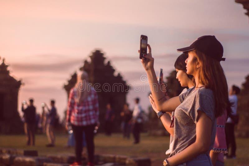 Woman Wearing Grey T-shirt Taking A Photo stock photos