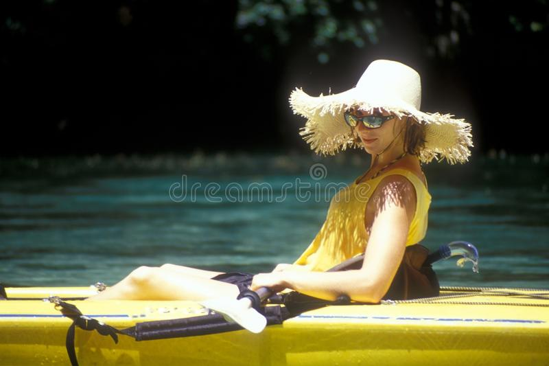 Download Woman Wearing Hat in Kayak stock image. Image of swimsuit - 12473339