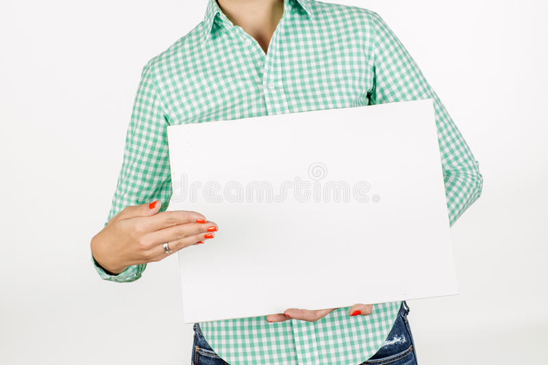 Woman wearing holding a white board with empty copy space. image royalty free stock image