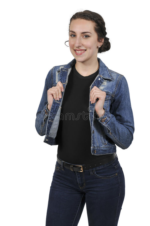 Woman wearing jeans and denim jacket stock photography