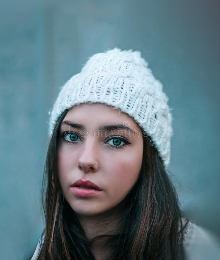 Woman Wearing Knitted White Hat With Nose Ring royalty free stock photo