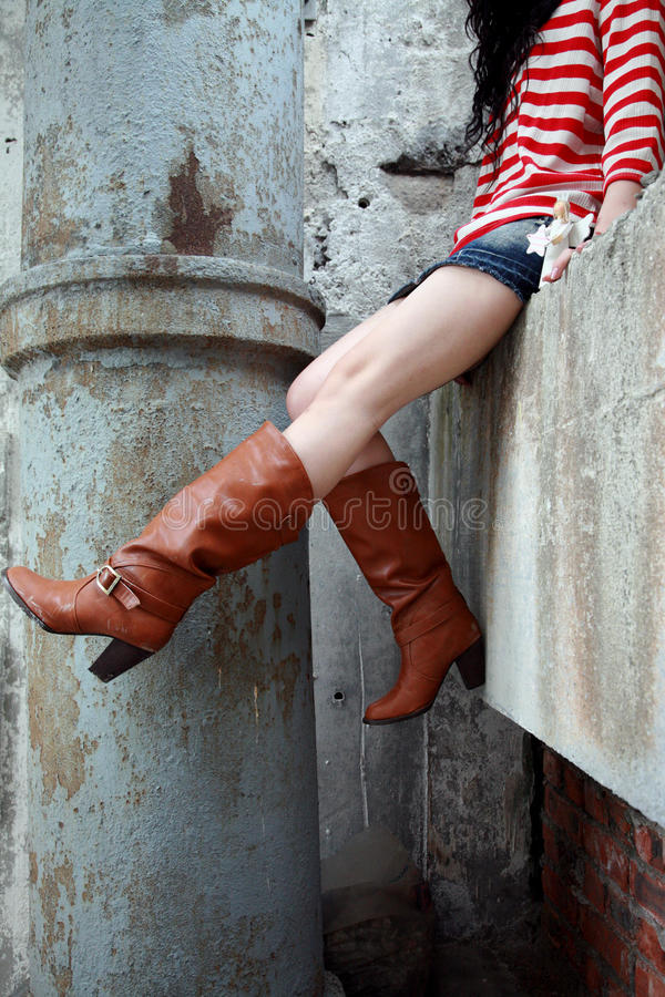 Woman wearing leather boots stock photo