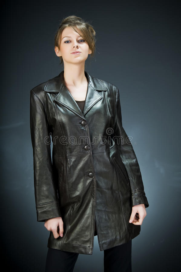 Woman wearing leather jacket royalty free stock photo