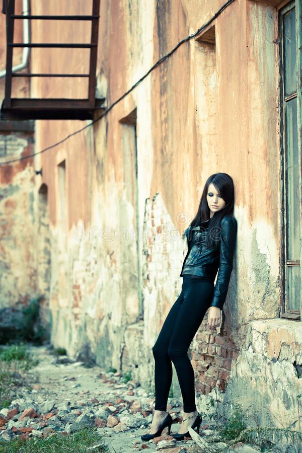 Woman wearing leather jacket stock images