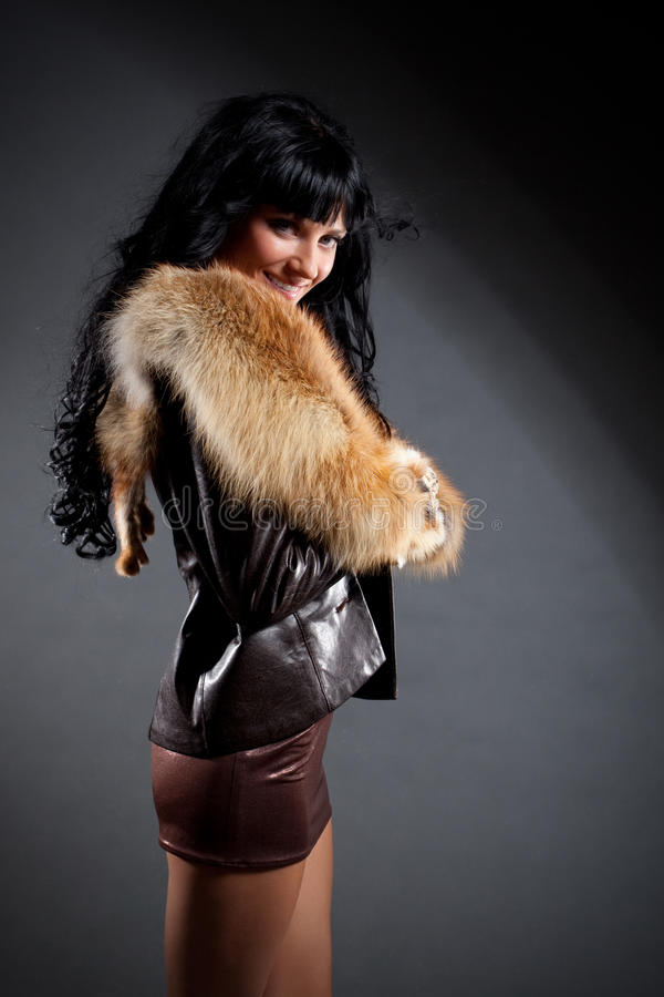 Woman wearing leather jacket with fur stock images