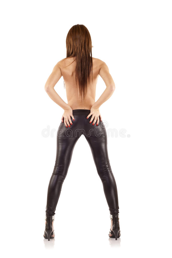 Woman wearing leather pants stock images