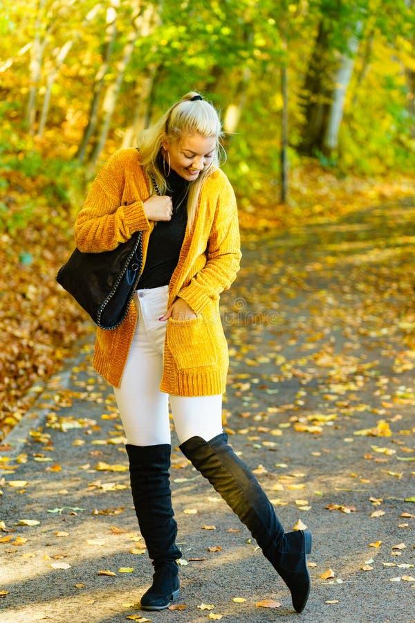Woman wearing orange autumn cardigan outdoor stock photos