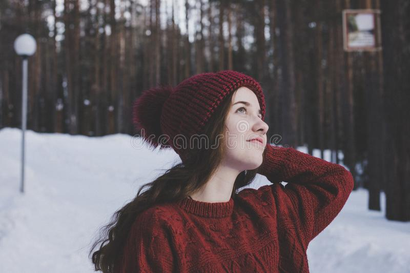 Woman Wearing Maroon Bobble Beanie on Winter Day stock photos