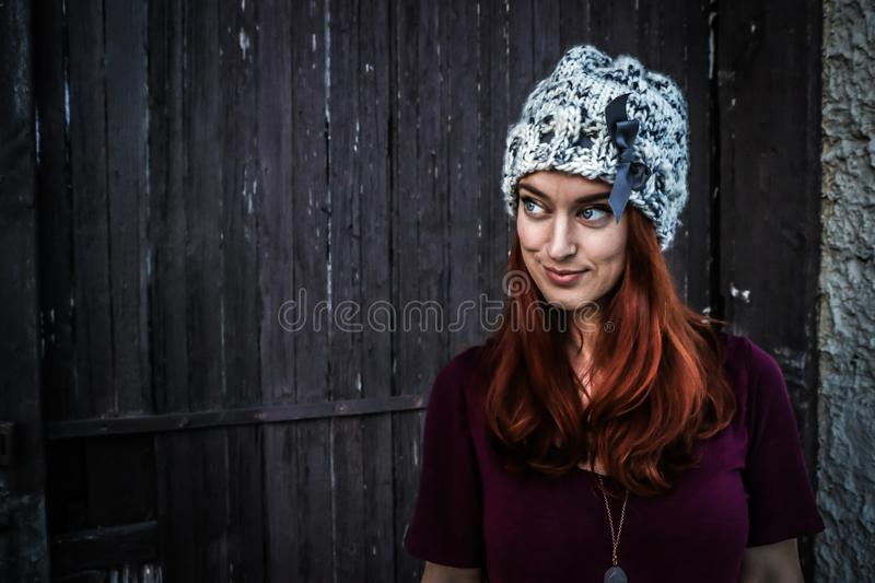 Woman Wearing Maroon Short-sleeved Shirt and White and Grey Knit Cap royalty free stock images
