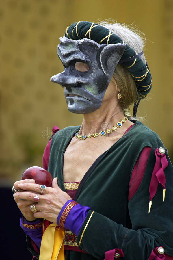 Download Woman Wearing A Mediaeval Mask While Holding A Red Apple Stock Photo - Image: 212080