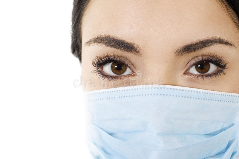 Woman wearing mouth cover mask stock photography