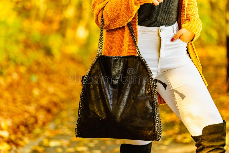 Woman wearing orange autumn cardigan outdoor stock photo