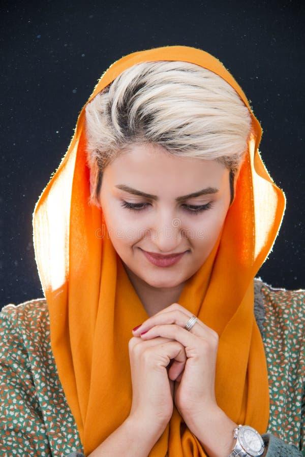 Woman Wearing Orange Hijab Headdress stock photo