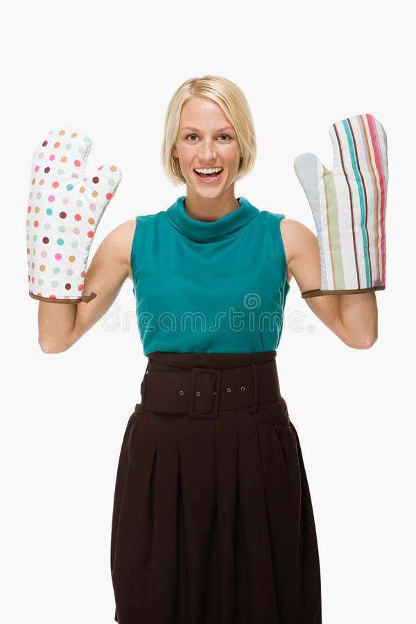 Woman wearing oven gloves royalty free stock photo