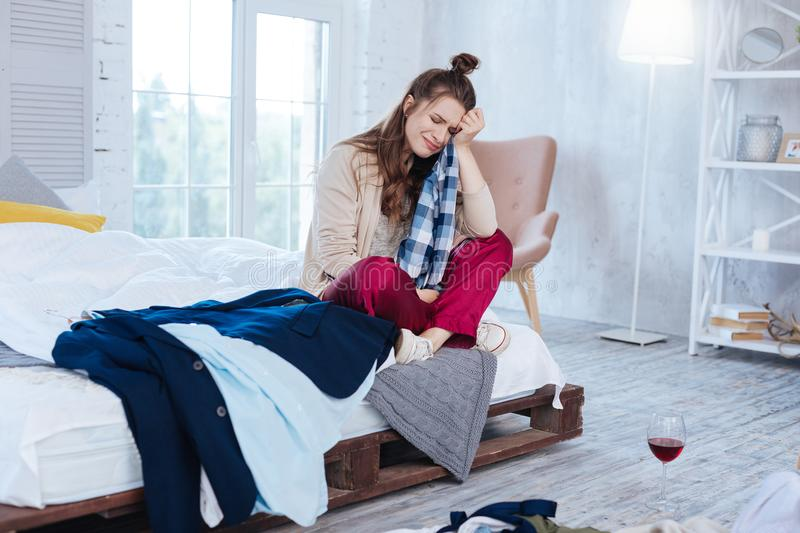 Woman wearing pajama crying in bedroom. Woman in pajama. Woman wearing nice comfortable pajama crying in bedroom after huge conflict with boyfriend stock images