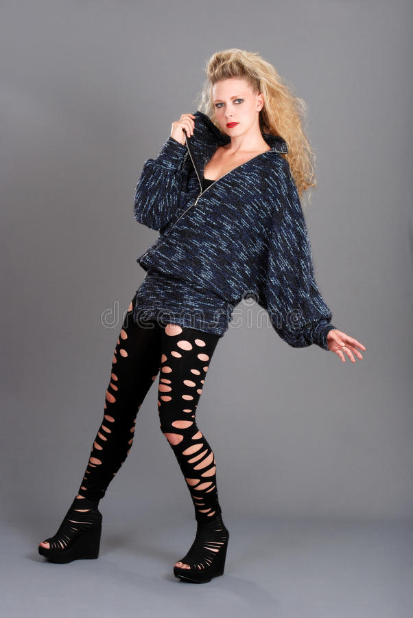 Woman wearing pants with holes and sweater stock photo