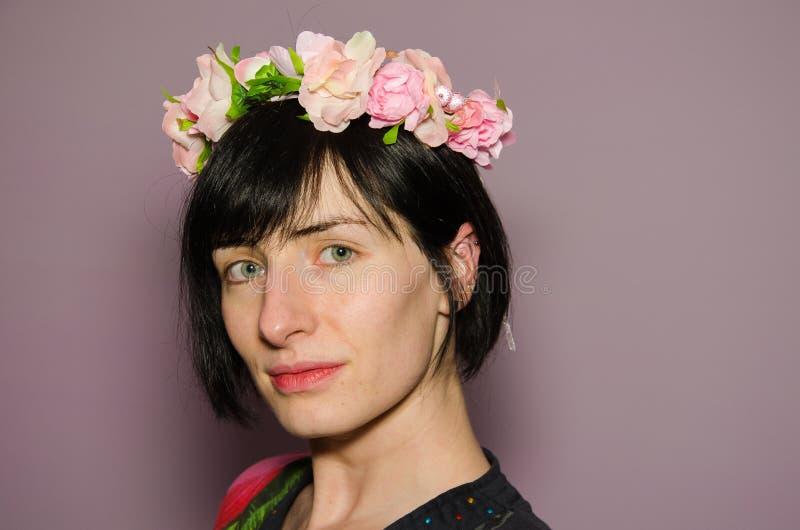Woman wearing pink flower crown stock photo