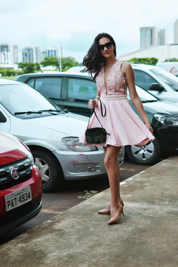 Woman Wearing Pink Sleeveless Dress Holding Black Bag royalty free stock photos