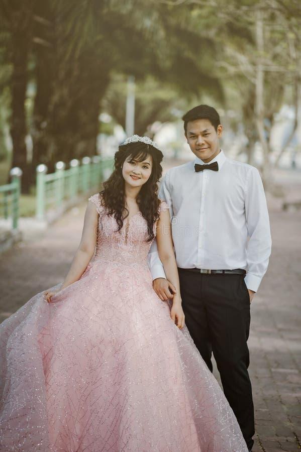 Woman Wearing Pink Wedding Gown Standing Next to Man Wearing White Dress Shirt royalty free stock photos