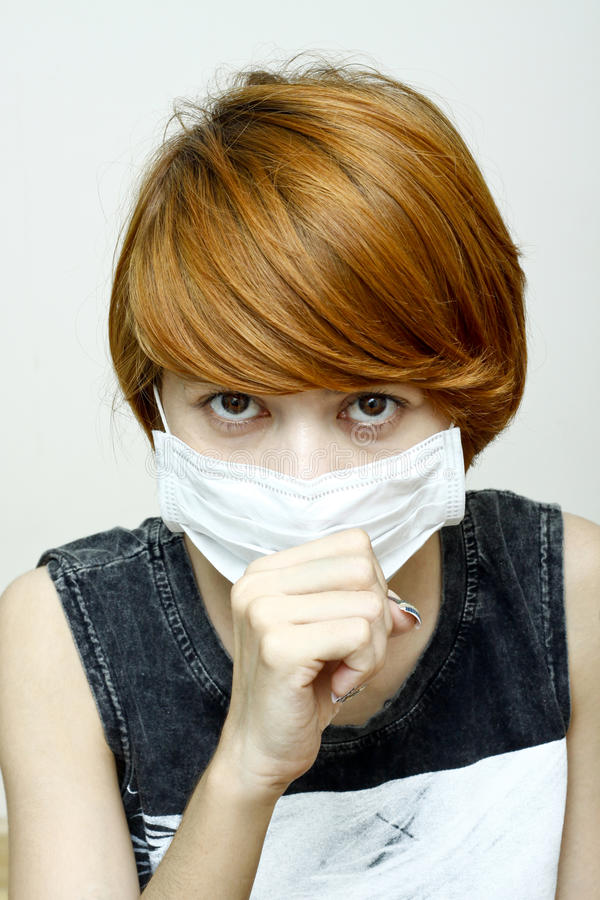 Woman wearing protective mask. Image of woman wearing protective mask,She is coughing stock photography