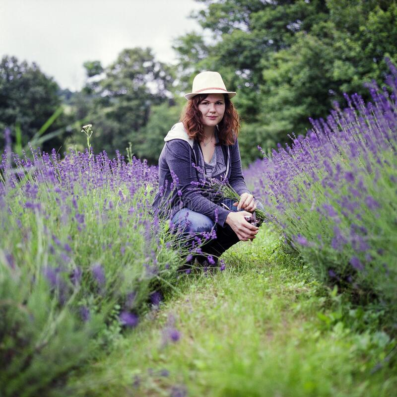 Woman Wearing Purple Jacket in Brown Hat during Day Time stock photos