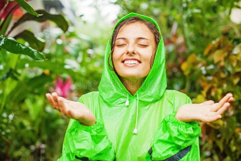 Woman wearing a raincoat royalty free stock photo