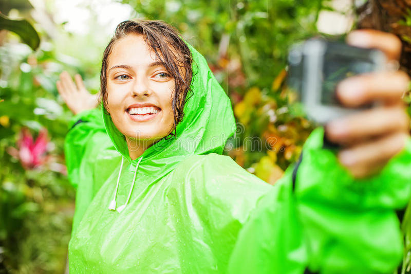 Woman wearing a raincoat stock images