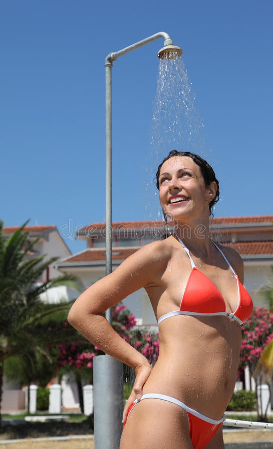 Woman Wearing Red Bathing Suit Takes Shower Royalty Free Stock Photos