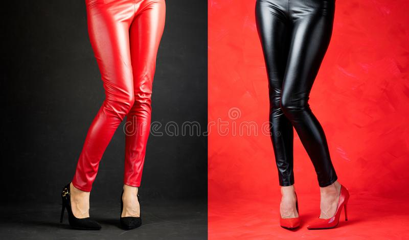 Woman wearing red and black leather pants and high heels. Beautiful woman`s legs wearing red and black leather pants and high heels royalty free stock photos