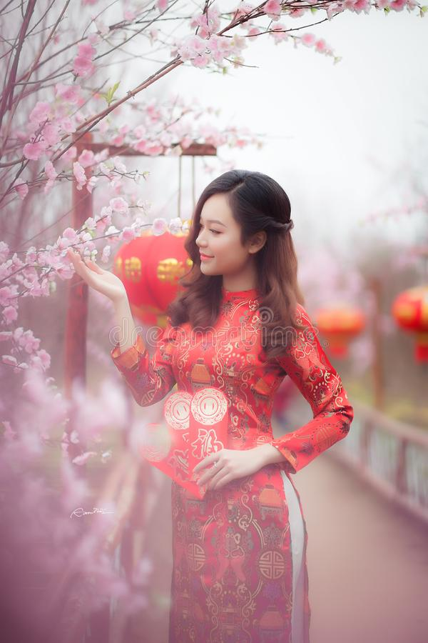Woman Wearing Red Chinese Traditional Dress stock photo