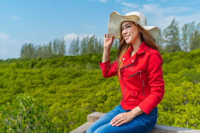 Woman wearing red clothes in wooden bridge at Tung Prong Thong or Golden Mangrove Field, Rayong, Thailand. Woman wearing red clothes in wooden bridge at Tung royalty free stock image