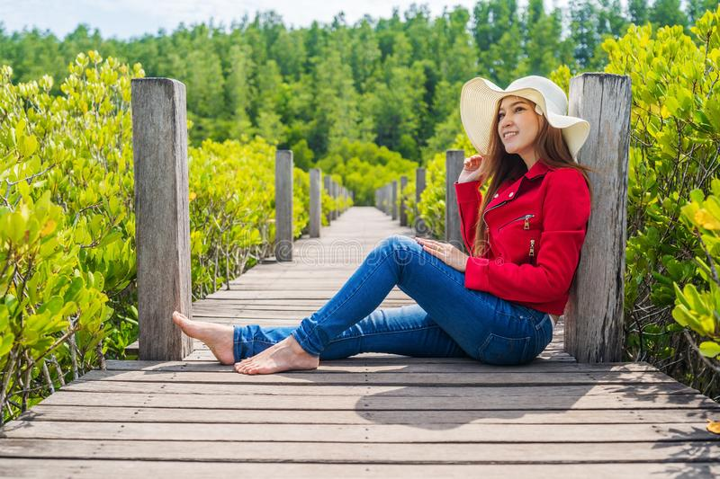 Woman wearing red clothes in wooden bridge at Tung Prong Thong or Golden Mangrove Field, Rayong, Thailand. Woman wearing red clothes in wooden bridge at Tung stock photos