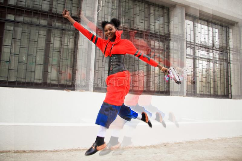 Woman Wearing Red Dress Jumping royalty free stock photography