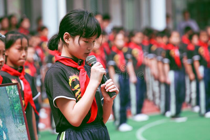 Woman Wearing Red Handkerchief On Neck Holding Black Microphone Free Public Domain Cc0 Image