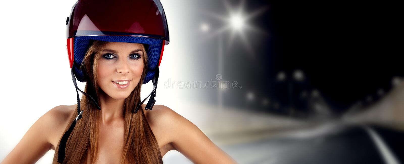 A Pretty Blonde Woman Wearing A Motorcycle Helmet Stock