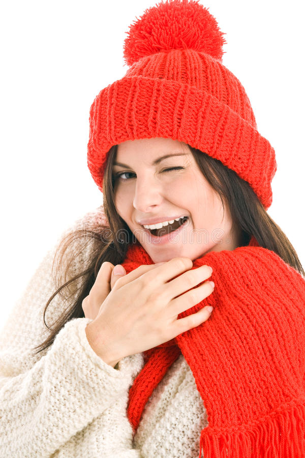 Woman wearing red scarf and cap stock photo
