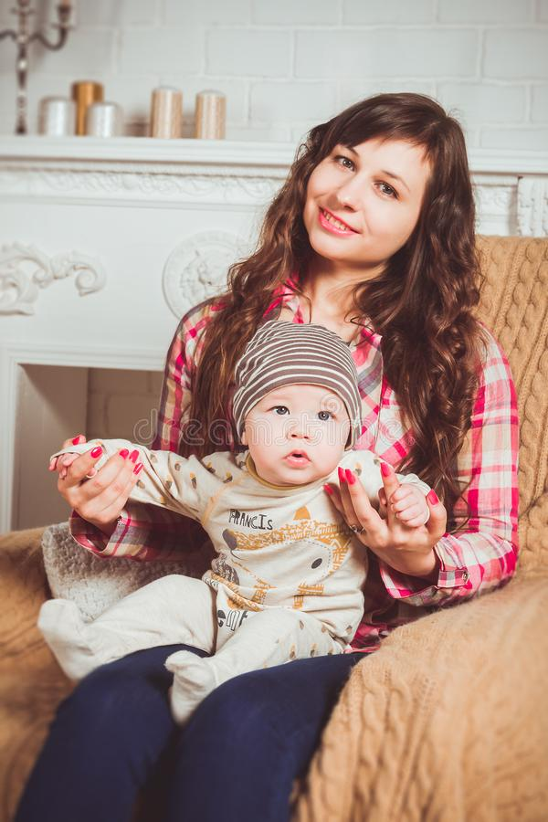 Woman Wearing Red And White Plaid Shirt Sitting On Chair Holding Baby Free Public Domain Cc0 Image