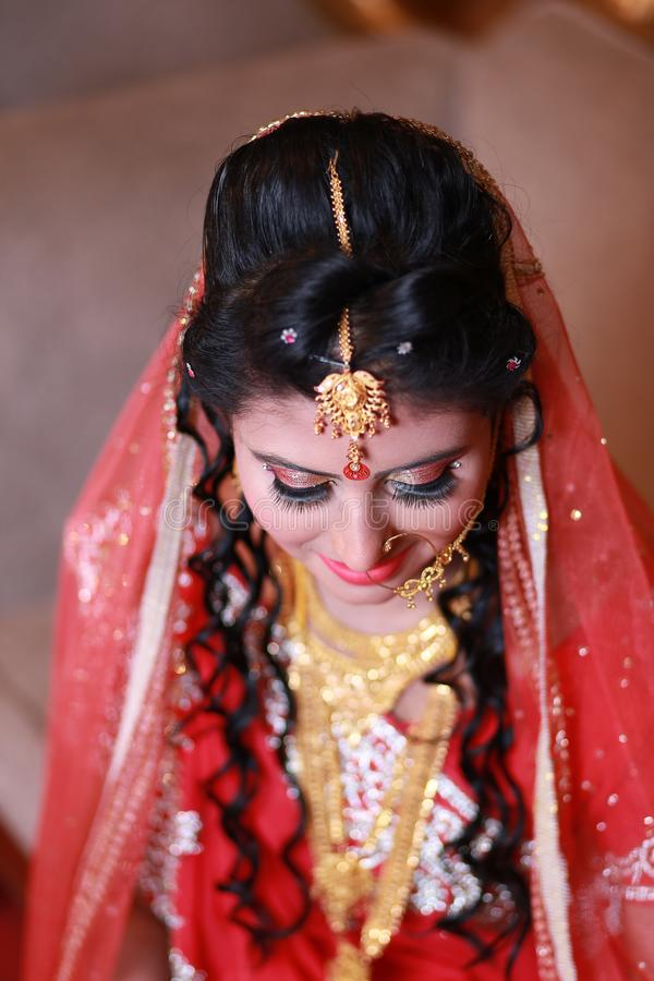 Woman Wearing Red and White Sari royalty free stock photography