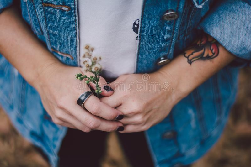 Woman wearing a ring. And holding flowers royalty free stock images