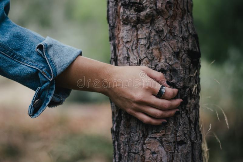 Woman wearing a ring. And holding flowers royalty free stock photos