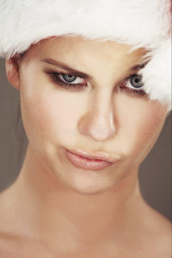 Woman wearing santas hat royalty free stock photo