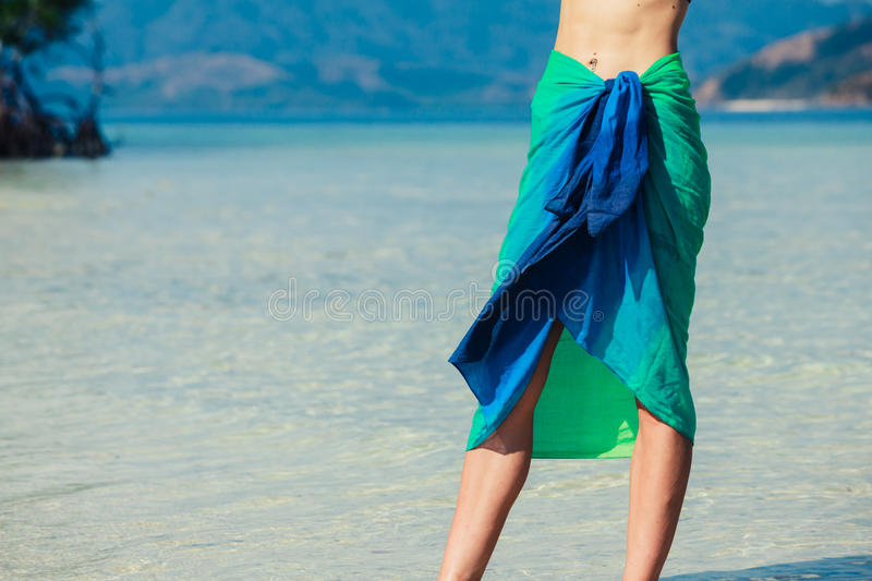 Woman wearing sarong on tropical beach stock images
