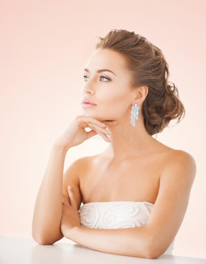 Download Woman Wearing Shiny Diamond Earrings Royalty Free Stock Photos - Image: 38098408