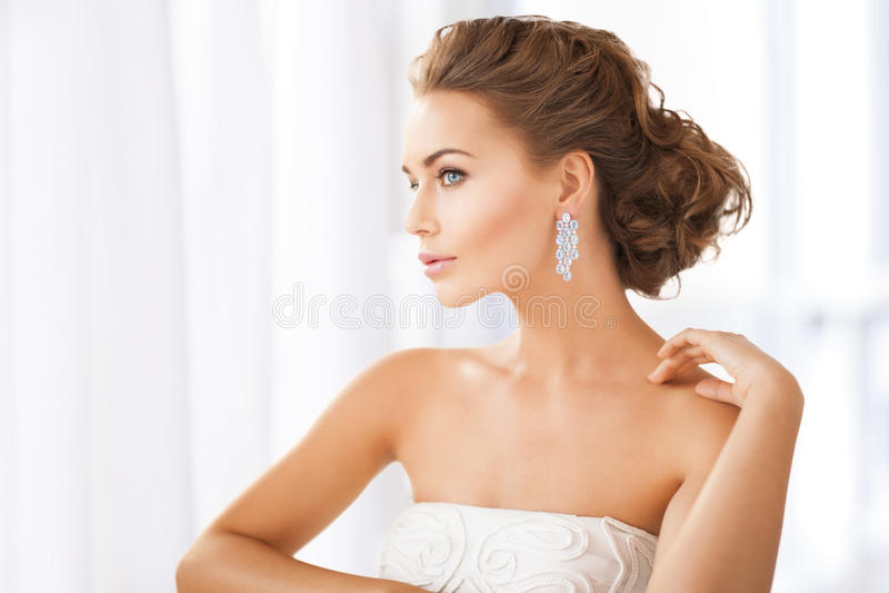 Download Woman Wearing Shiny Diamond Earrings Stock Photo - Image: 38098434