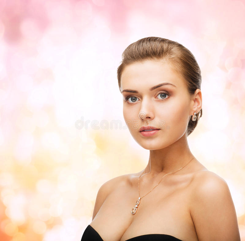 Woman wearing shiny diamond earrings and pendant stock photo image beauty and jewelry concept woman wearing shiny diamond earrings and pendant aloadofball Gallery